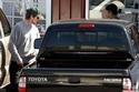 كريستيان بيل مع سيارته تويوتا تاكوما